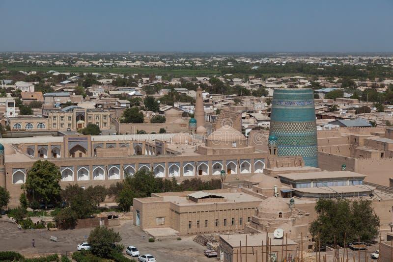 Kalta Minor minaret in Khiva, Khorezm Region, Uzbekistan. Overview of oriental buildings of old city of Itchan Kala. Khiva, Uzbekistan royalty free stock photos
