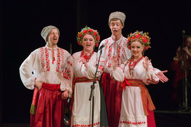 Kalyna. DNIPROPETROVSK, UKRAINE - APRIL 3, 2016: Members of the Folklore Ensemble KALYNA perform UKRAINE at State Opera and Ballet Theatre royalty free stock photography
