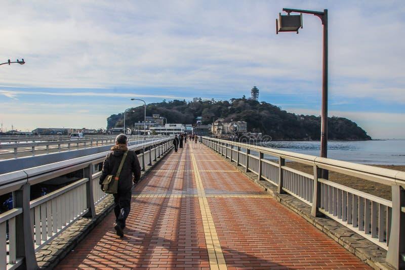 Long bridge to Enoshima island and tourist on it stock photo