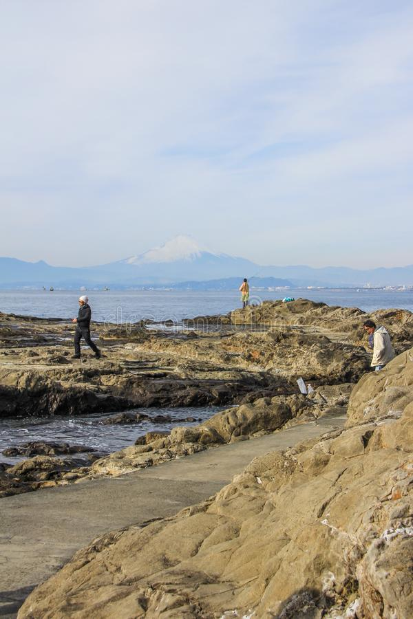 Fishermen on the rocks of Enoshima royalty free stock images