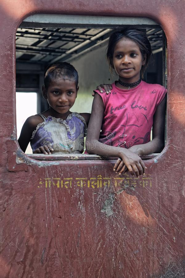 Portrait of young girls in the train. KAMALIGHAT, INDIA, November 6, 2017 : Portrait of young girls in the train. Train travels through tunnels and bridges and royalty free stock image