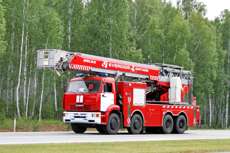 KAMAZ fire ladder. CHELYABINSK REGION, RUSSIA - AUGUST 14, 2009: Red KAMAZ fire ladder at the interurban road royalty free stock photography
