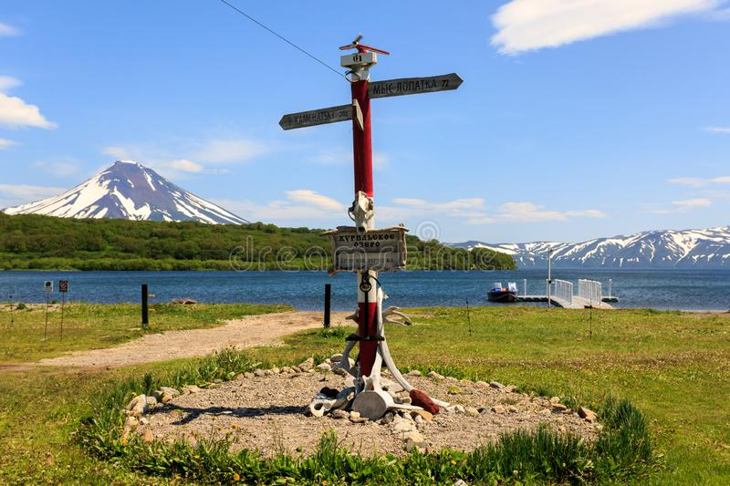 Kamchatka Peninsula, Russia - July 7, 2018: Direction sign post near Kurile Lake against the background of the volcano Ilyinsky stock images