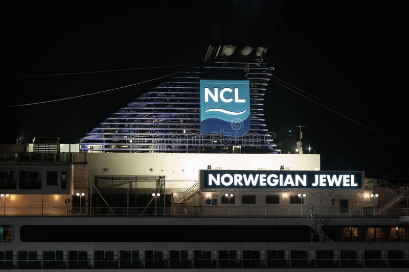 Night view of upper deck of Cruise Liner Norwegian Jewel with pipe spewing smoke stock images