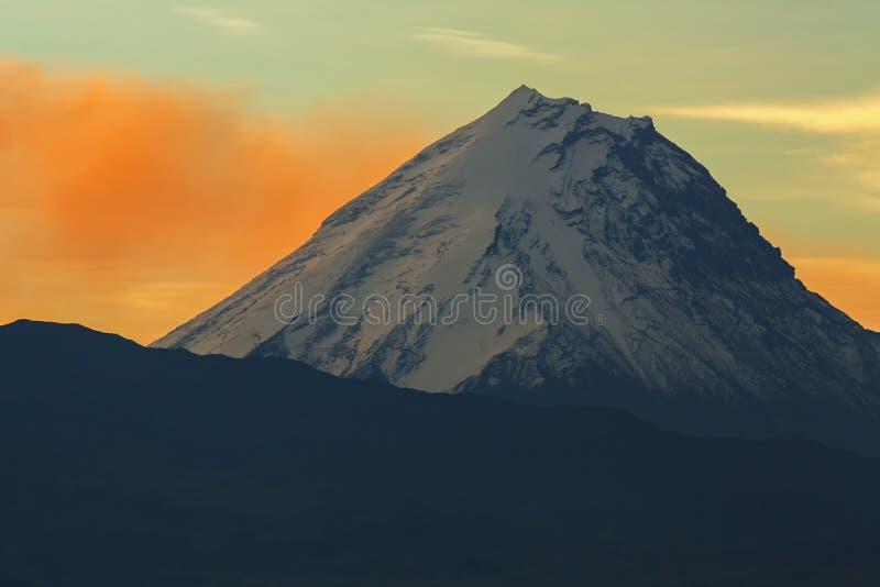 Kamen volcano on background of sunrise. Kluchevskaya group volcanoes. Kamen volcano on the background of sunrise. Kluchevskaya group of volcanoes stock photo