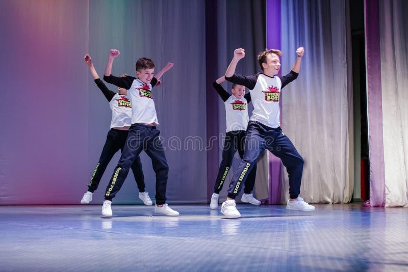 Young boys cheerleaders perform at the city cheerleading championship. Kamenskoye, Ukraine - October 14, 2018: Championship of the city of Kamenskoye in stock images