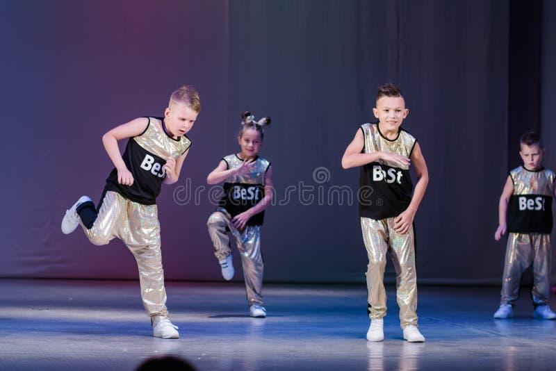 Young boys cheerleaders perform at the city cheerleading championship. Kamenskoye, Ukraine - October 14, 2018: Championship of the city of Kamenskoye in royalty free stock photography