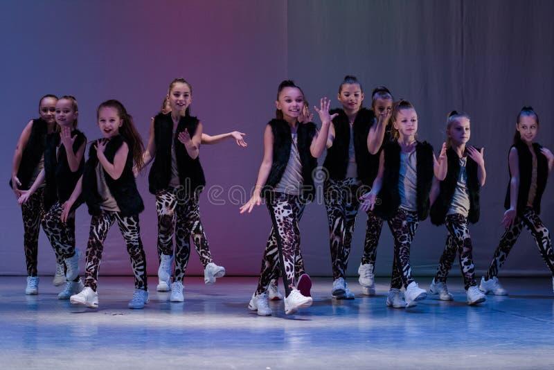 Young cheerleaders perform at the city cheerleading championship. Kamenskoye, Ukraine - October 14, 2018: Championship of the city of Kamenskoye in cheerleading royalty free stock photo