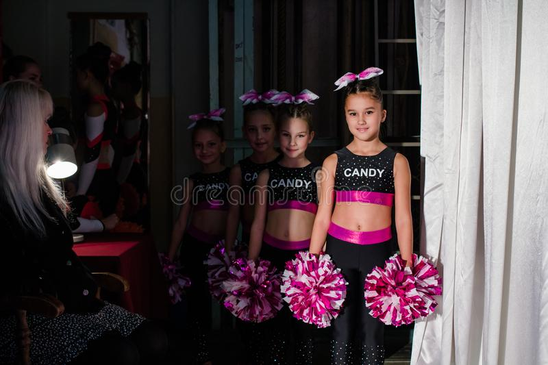 Championship of the city of Kamenskoye in cheerleading among duets and teams, young cheerleaders perform at the city cheerleading royalty free stock images