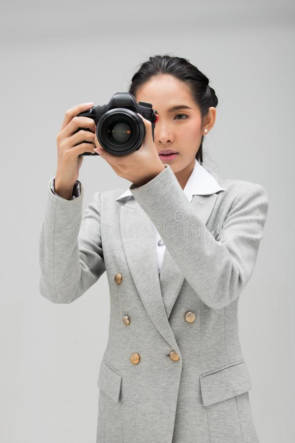 Kamera f?r universitetsstudentPhotographer h?ll royaltyfri fotografi