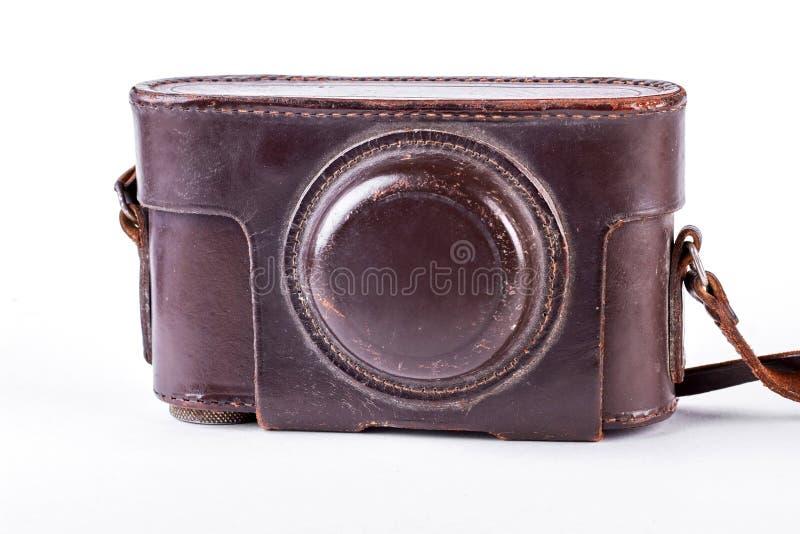 Kamera i gammalt brunt fall royaltyfri bild