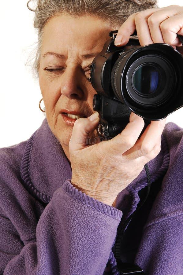 kameraladypensionär fotografering för bildbyråer