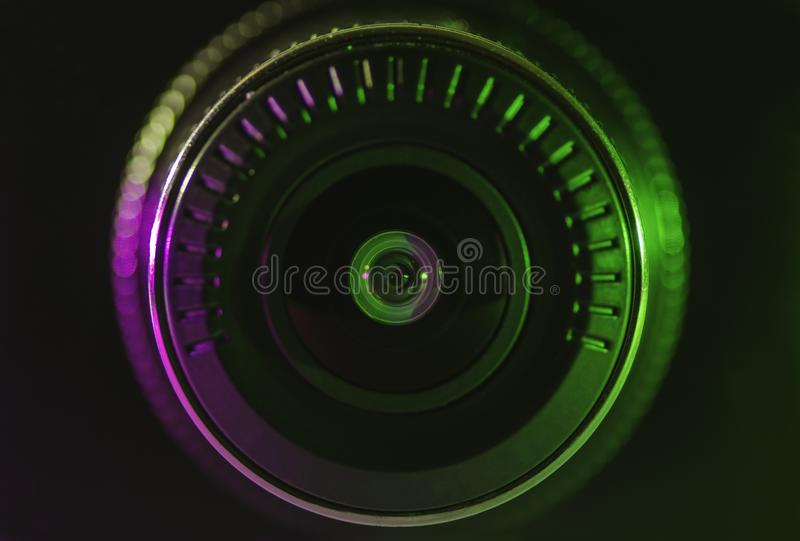 Kameraobjektiv mit grüner rosa Farbe stockfoto