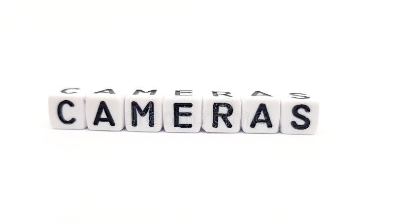 kamery formułują budują z białymi sześcianami i czarnymi listami na białym tle obraz stock