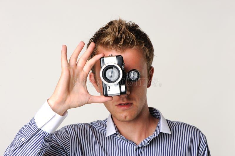 kamery fotograf gospodarstwa zdjęcie stock
