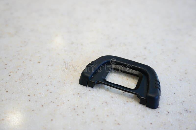 Kamery gumowy eyecup na marmuru stole zdjęcia royalty free