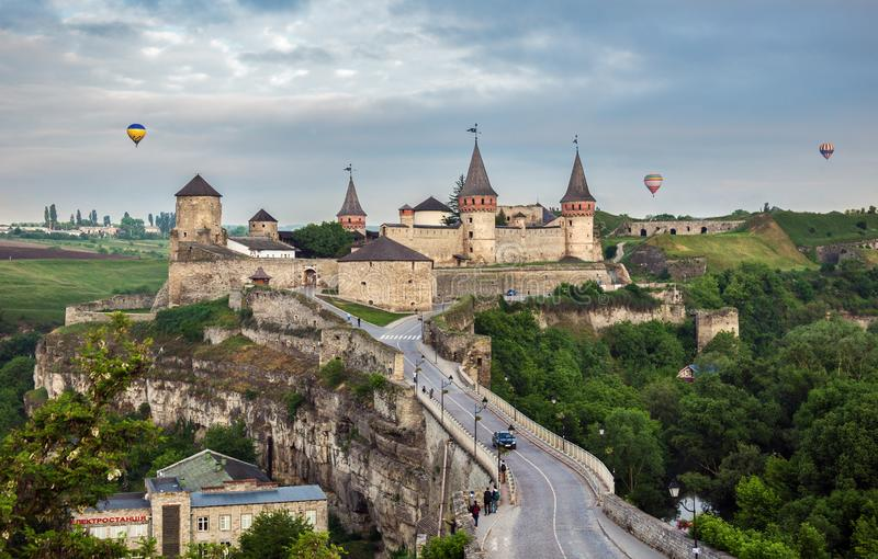 Kamianets-Podilsky fortress and balloons. Kamianets-Podilsky, Ukraine - May 20, 2018: View of Kamianets-Podilsky famous ancient fortress during the balloon stock images
