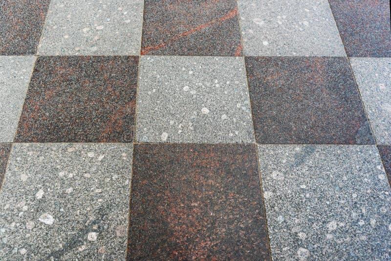 Kamień płytki szarość brzmienia, rozkładać w szachownica wzorze obraz stock