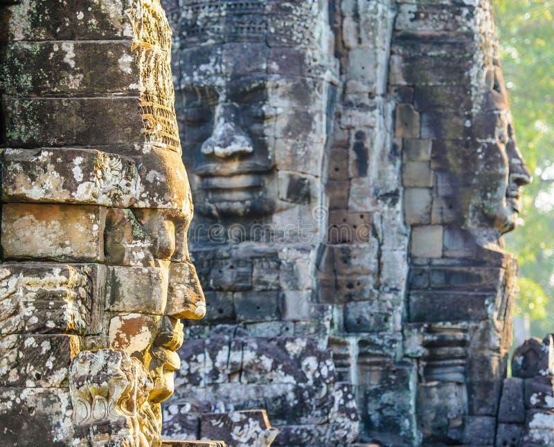 Kamień stawia czoło przy bayon świątynią w siem przeprowadza żniwa, Cambodia 12 fotografia stock