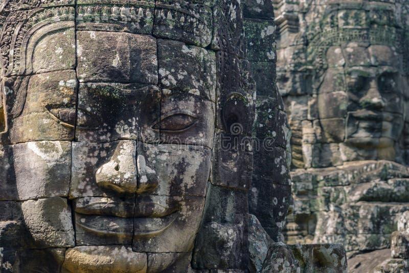 Kamień stawia czoło w Angkor Thom świątyni, selekcyjna ostrość Buddyzm medytacji pojęcie, świat podróży sławny miejsce przeznacze obraz stock