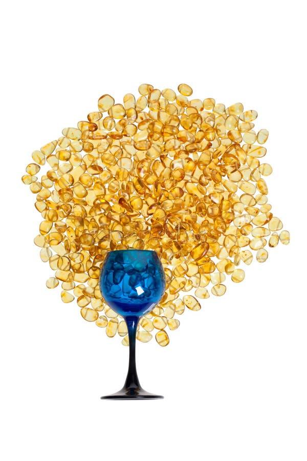 Kamienie żółty bursztyn i błękitny szkło fotografia stock