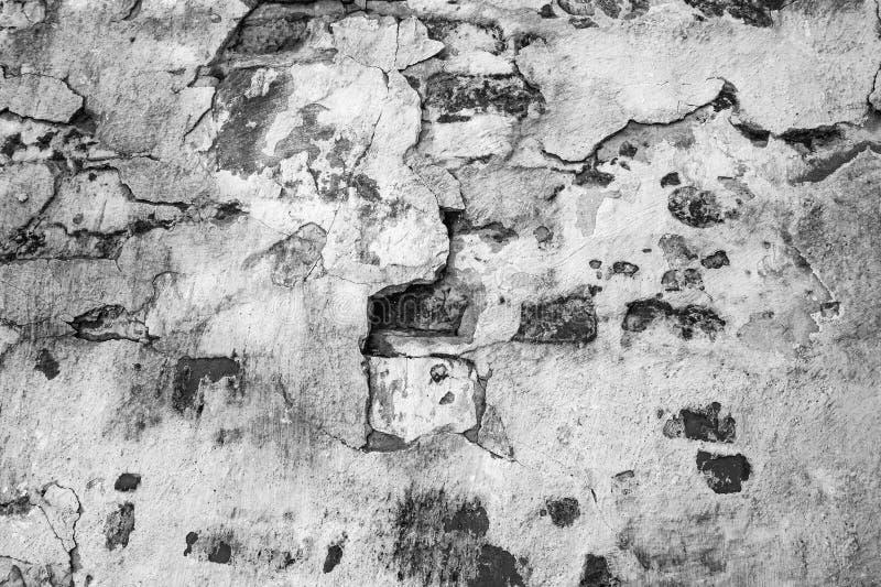 Kamienna ściana Textured abstrakcjonistycznego tło stary taktujący kamień czarny white obraz stock