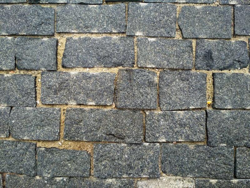 Kamienna cegła Tekstury ściana z cegieł W górę brickly szarych płytek, Ulicy tekstury kamienny tło zdjęcie stock