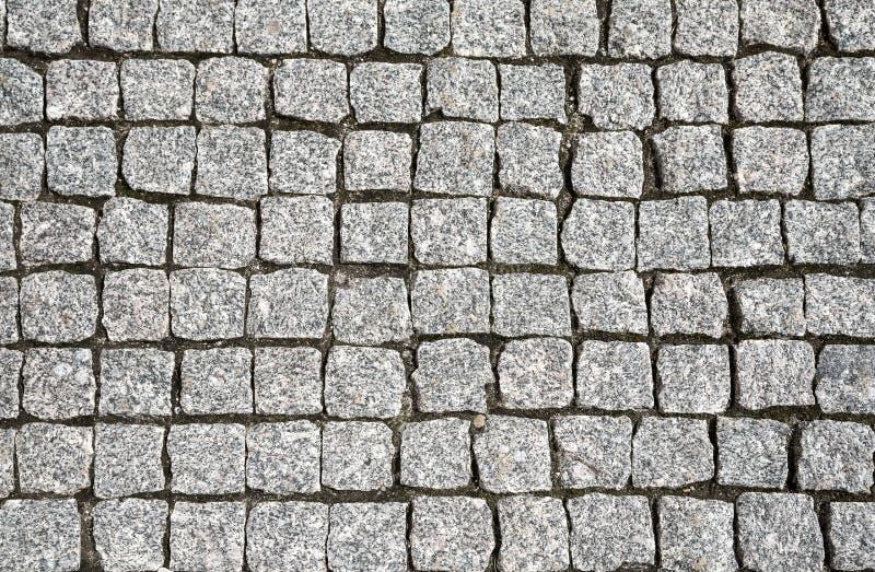 Kamienna uliczna drogowego bruku tekstura obraz royalty free