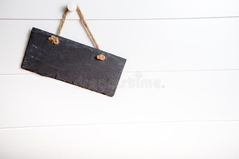 Kamienny szyldowy obwieszenie na drzwi zdjęcia stock