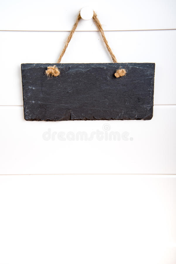 Kamienny szyldowy obwieszenie na drzwi obraz stock