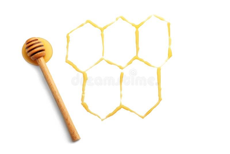 Kammen met honing en dipper op witte achtergrond worden getrokken die stock afbeeldingen