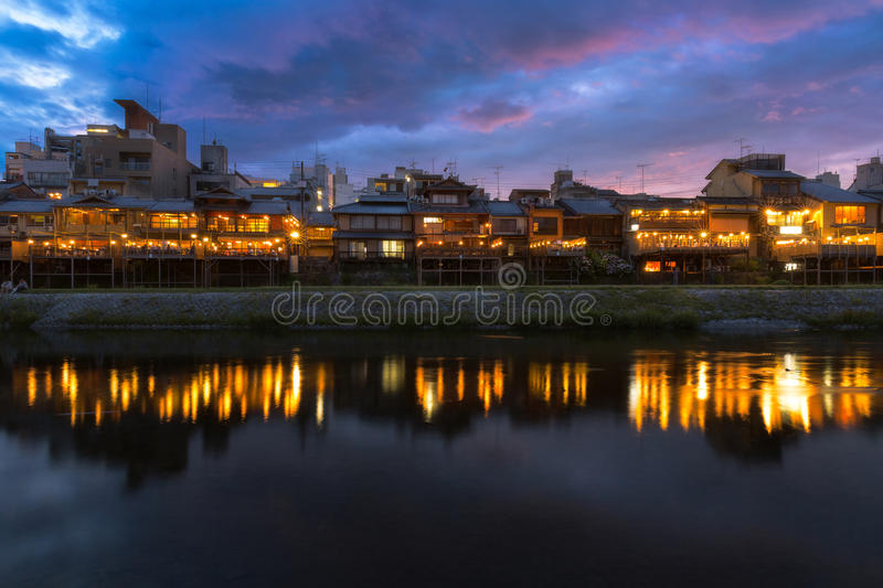 Kamogawa river nearby Gion in sunset. Old house and restaurant in Kamo river or kamogawa river at sunset, Gion, Kyoto, Japan royalty free stock photo
