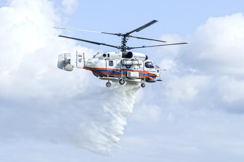 Kamov Ka-32A11BC helicopter dropping water royalty free stock photography