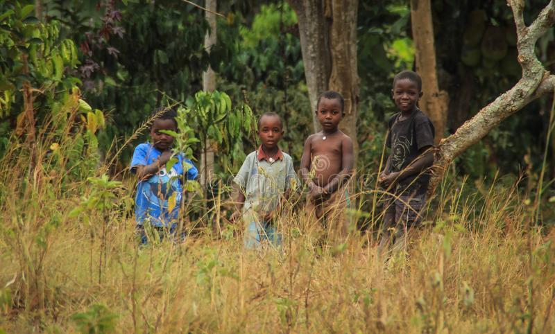 African village children play near their homes in the Kampala suburb royalty free stock image