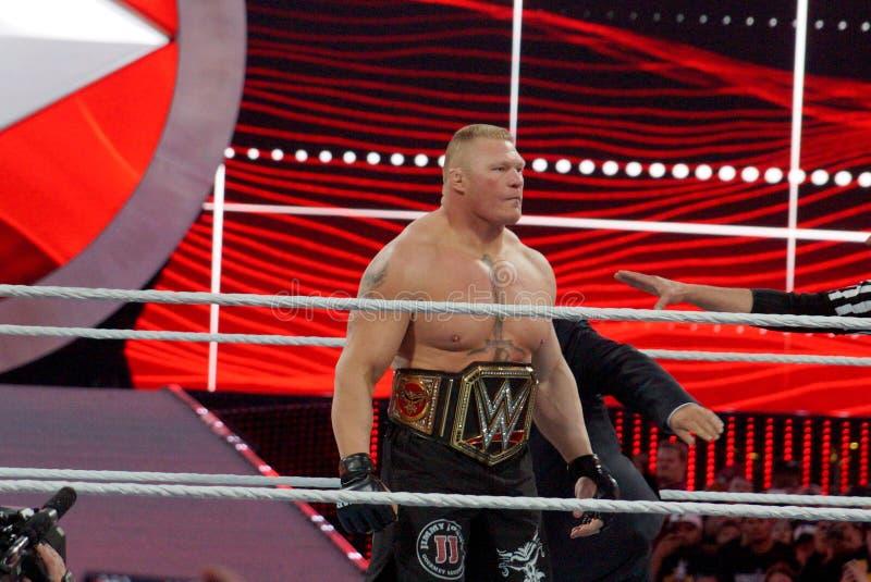 Kampioen Brock Lesner met Kampioenschapsriem op taille in ring royalty-vrije stock afbeelding