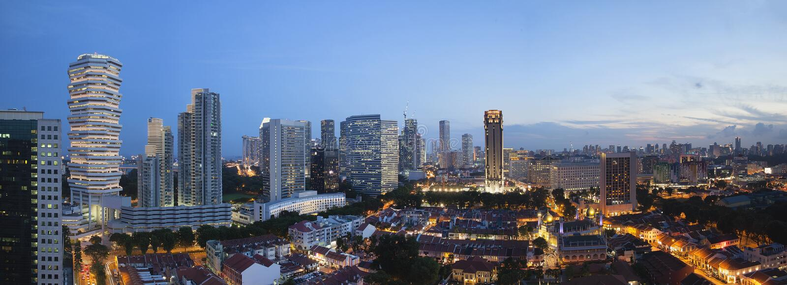Kampong Glam in Singapore Aerial View at Blue Hour Panorama. Kampong Glam with Singapore City Skyline and Sultan Mosque Aerial View during Evening Blue Hour stock photo