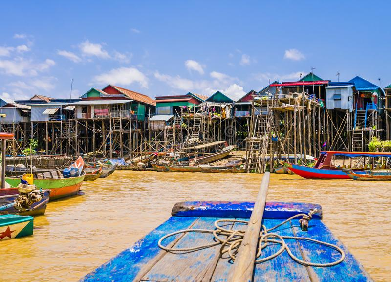 Kampong Phluk floating village. Picturesque Kampong Phluk floating village with multicolored boats and stilt houses, Tonle Sap lake, Siem Reap Province, Cambodia stock photos