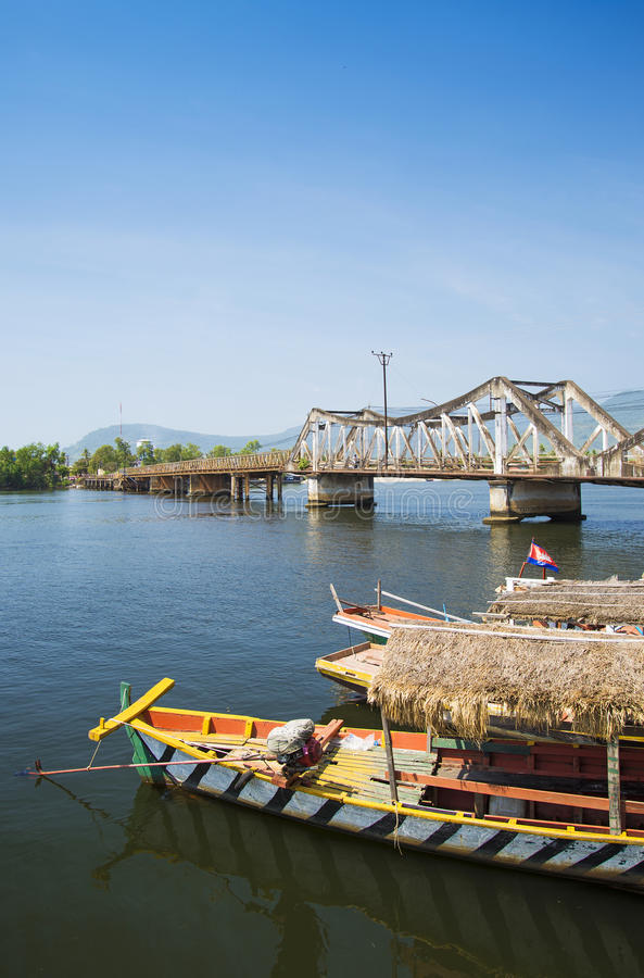 Kampot bridge in cambodia. Kampot bridge and boat in cambodia stock photography
