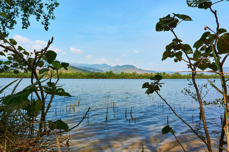 Kampot Cambodia River with Mountains in Background and beautiful landscape. At sunny day royalty free stock image