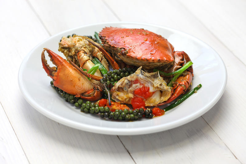 Kampot green pepper crab. Stir-fried crab with green kampot pepper, cambodian cuisine royalty free stock images