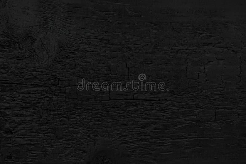 Kan användas som en vykort Bränt trä texturerar arkivbild