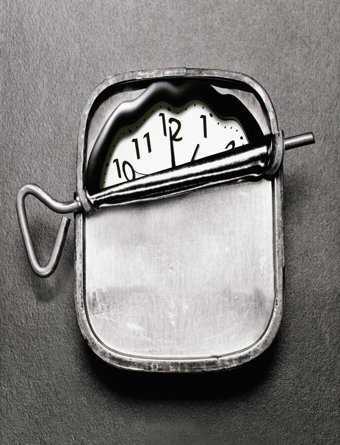 kan clock sardinen arkivbild