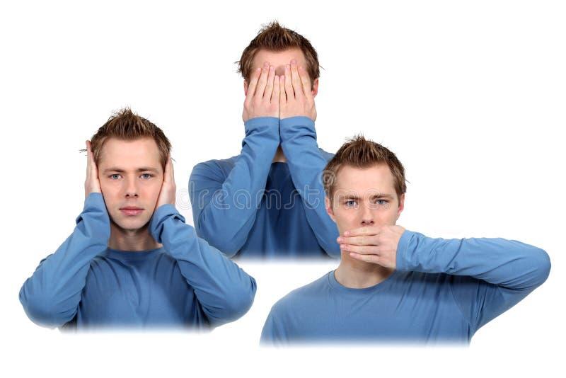 Kan inte se, kan inte höra, kan inte tala. royaltyfria foton