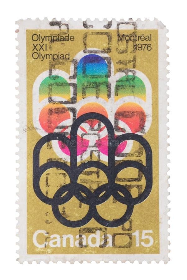 KANADA - CIRCA 1973: en stämpel skrivev ut i showerna 1st Oly arkivbilder