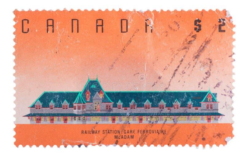 KANADA - CIRCA 1989: stämpel som in skrivs ut, showjärnvägstatistik arkivbild