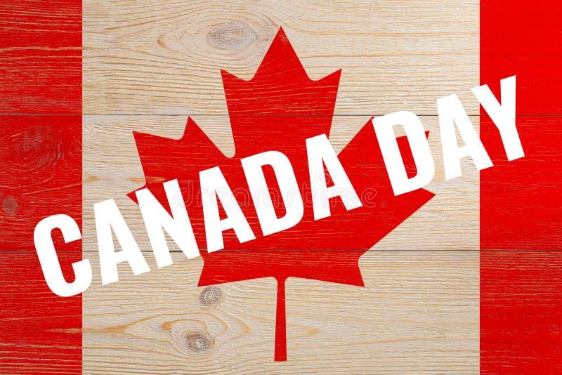 Kanada dzień na malującej flaga zdjęcie royalty free