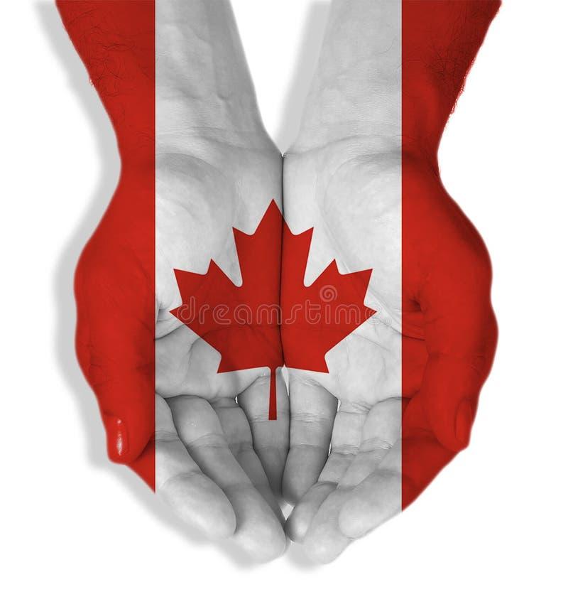 Kanada-Flagge mit den Händen zusammen lizenzfreie stockbilder
