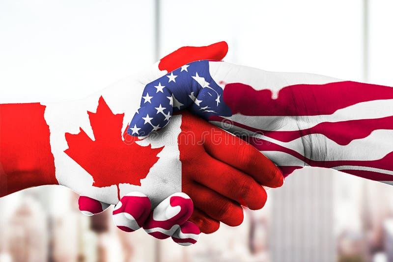 Kanada-Flagge mit den Händen zusammen stockbild