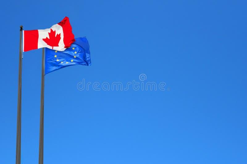 Kanadensare- och européflaggor royaltyfri foto