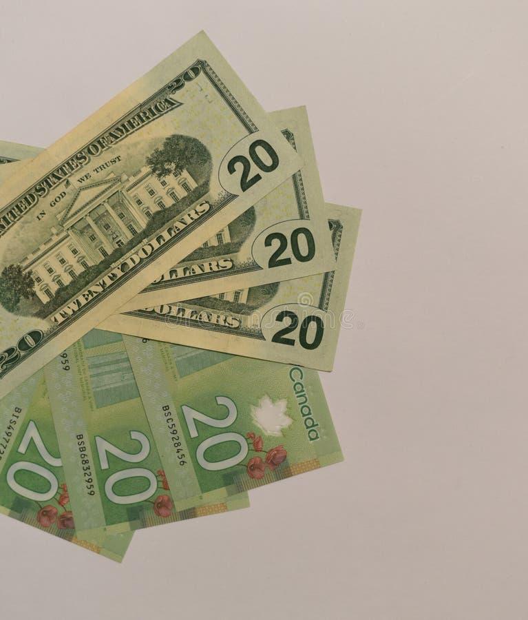 Kanadensare- och USA dollarvaluta av valör 20 arkivfoton